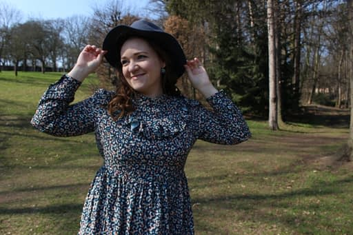 A woman wearing a French Poetry Leo dress